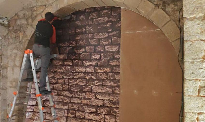 colocación de vinilo sobre pared