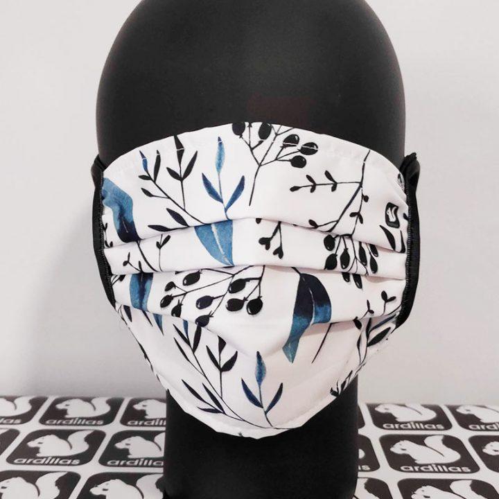 Mascarilla reutilizable diseño Hojas en blanco
